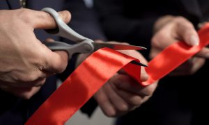 red tape cutting stock image