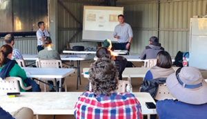 Vegetable and potato officer Callum Fletcher speaking to growers in Carnarvon, WA, while Vegetables WA Vietnamese industry extension officer, Truyen Vo, translates. Image courtesy of AUSVEG